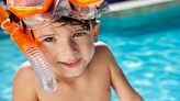 child swimming with snorkel