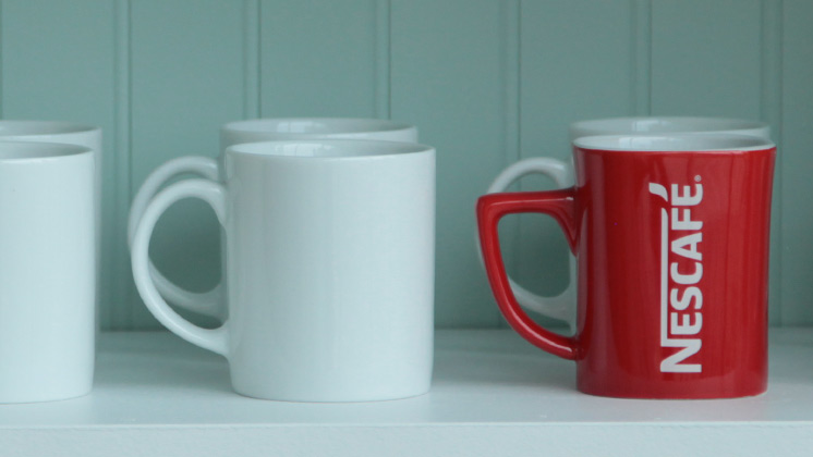 red Nescafe mug