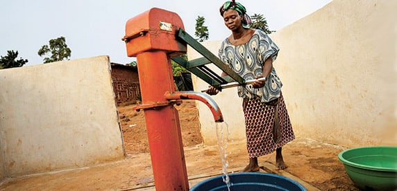 woman pumping water